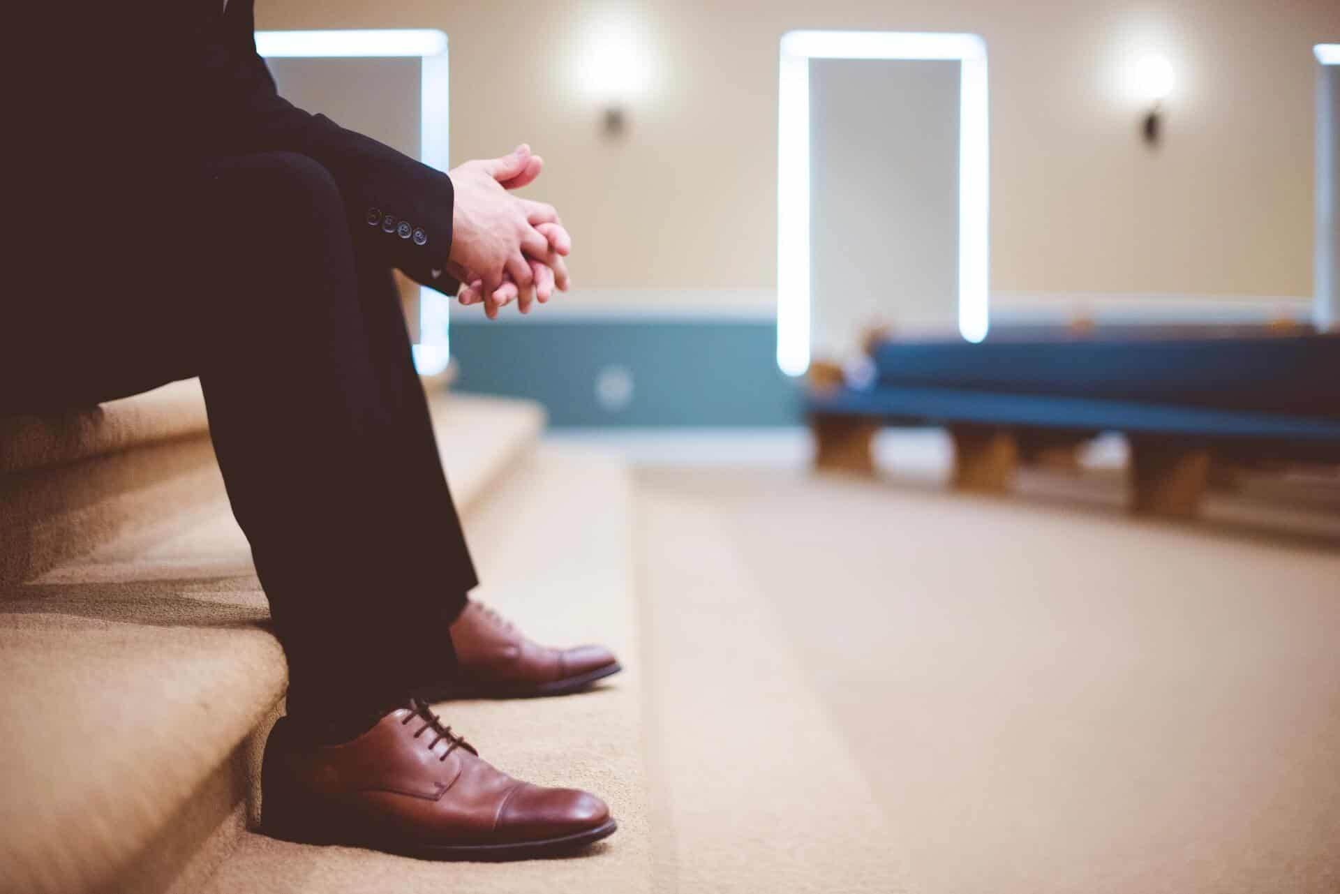 Man sitting on stage at church