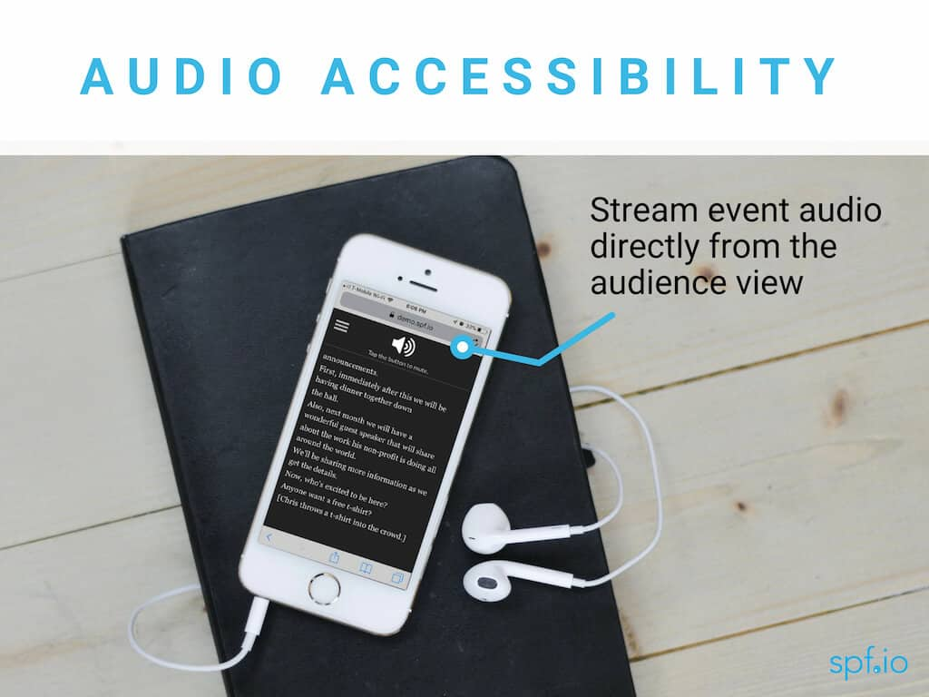 Audio accessibility - stream event audio directly from the audience view. Image of white iPhone on black notebook with headphones plugged in and audio enabled in audience view.