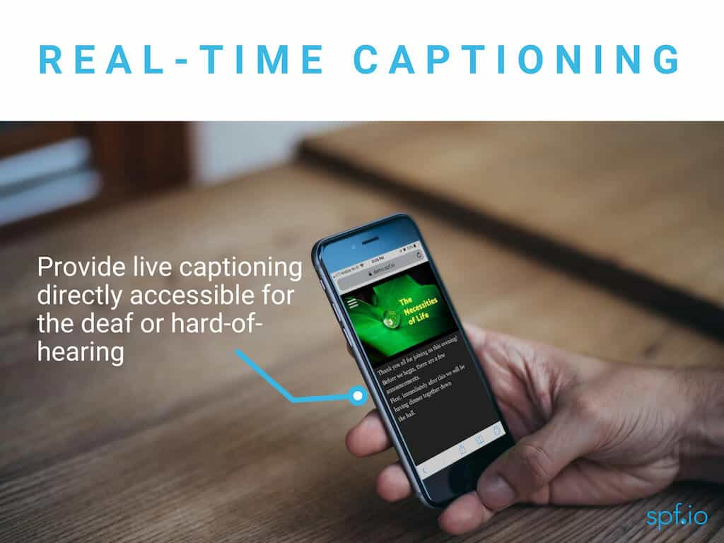 Real-time captioning - provide live captioning directly accessible for the deaf and hard-of-hearing. Image of man's hand holding black iPhone viewing audience view with slides and text captions.